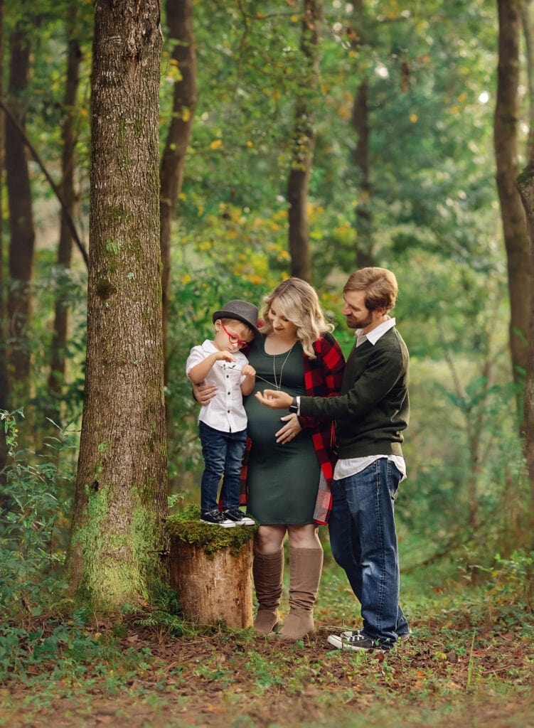 stunning photo of family of four in forest