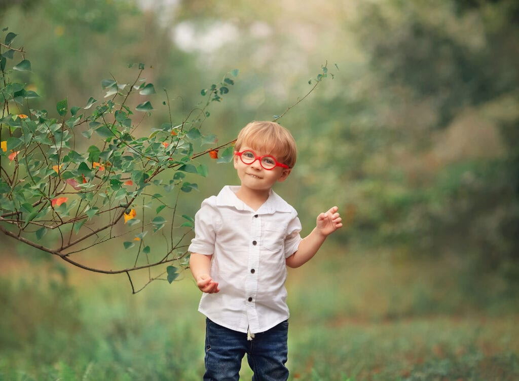 little boy with red glasses