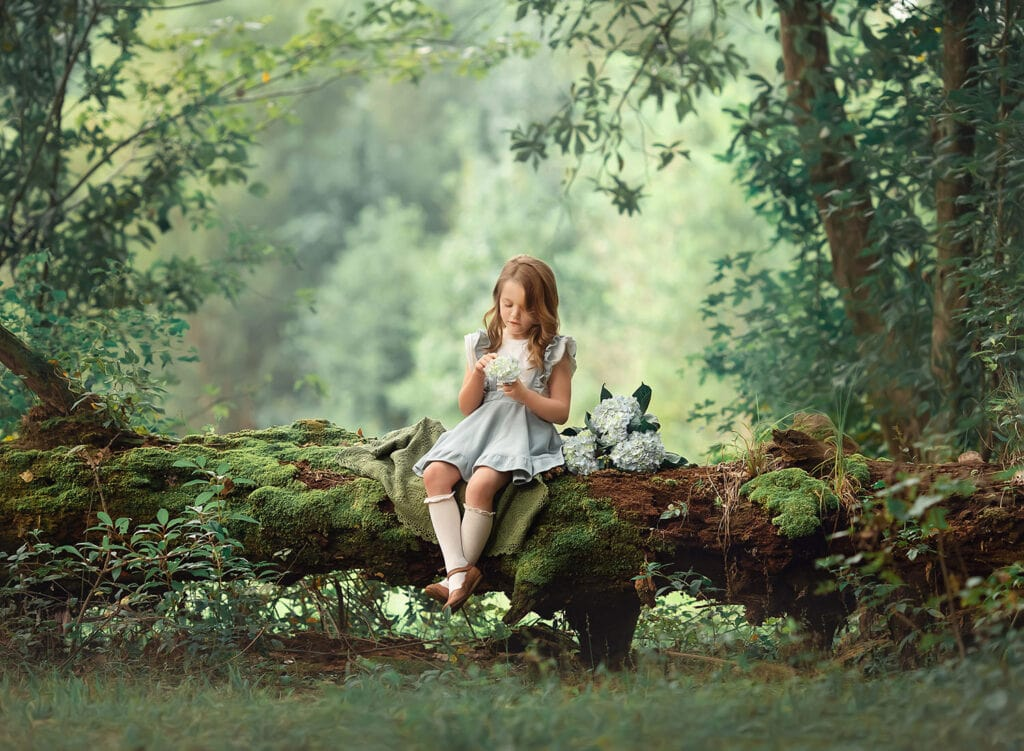Stunning photo of girl on mossy tree