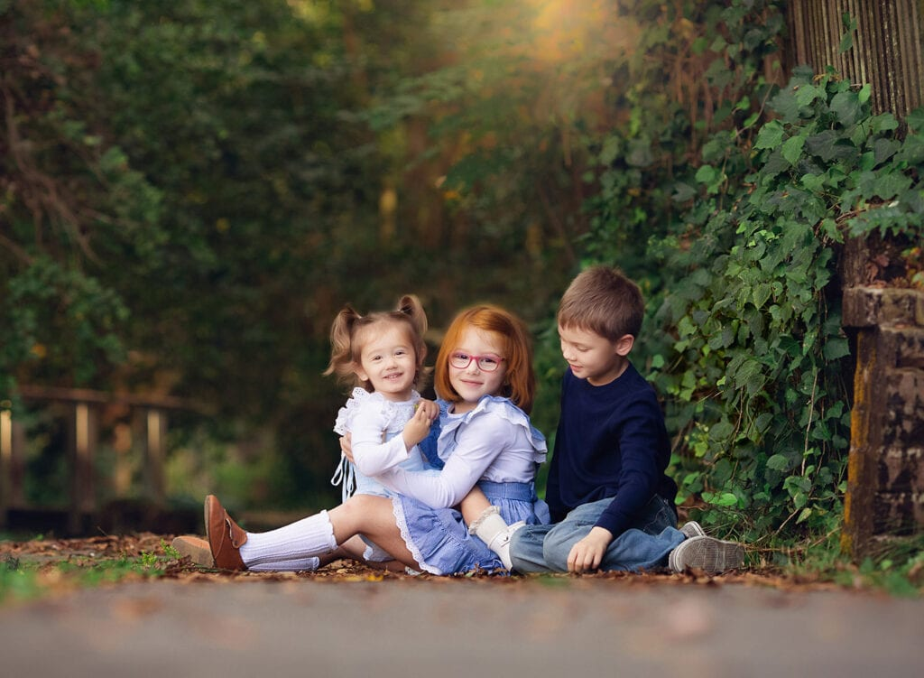 fine art photo of three siblings